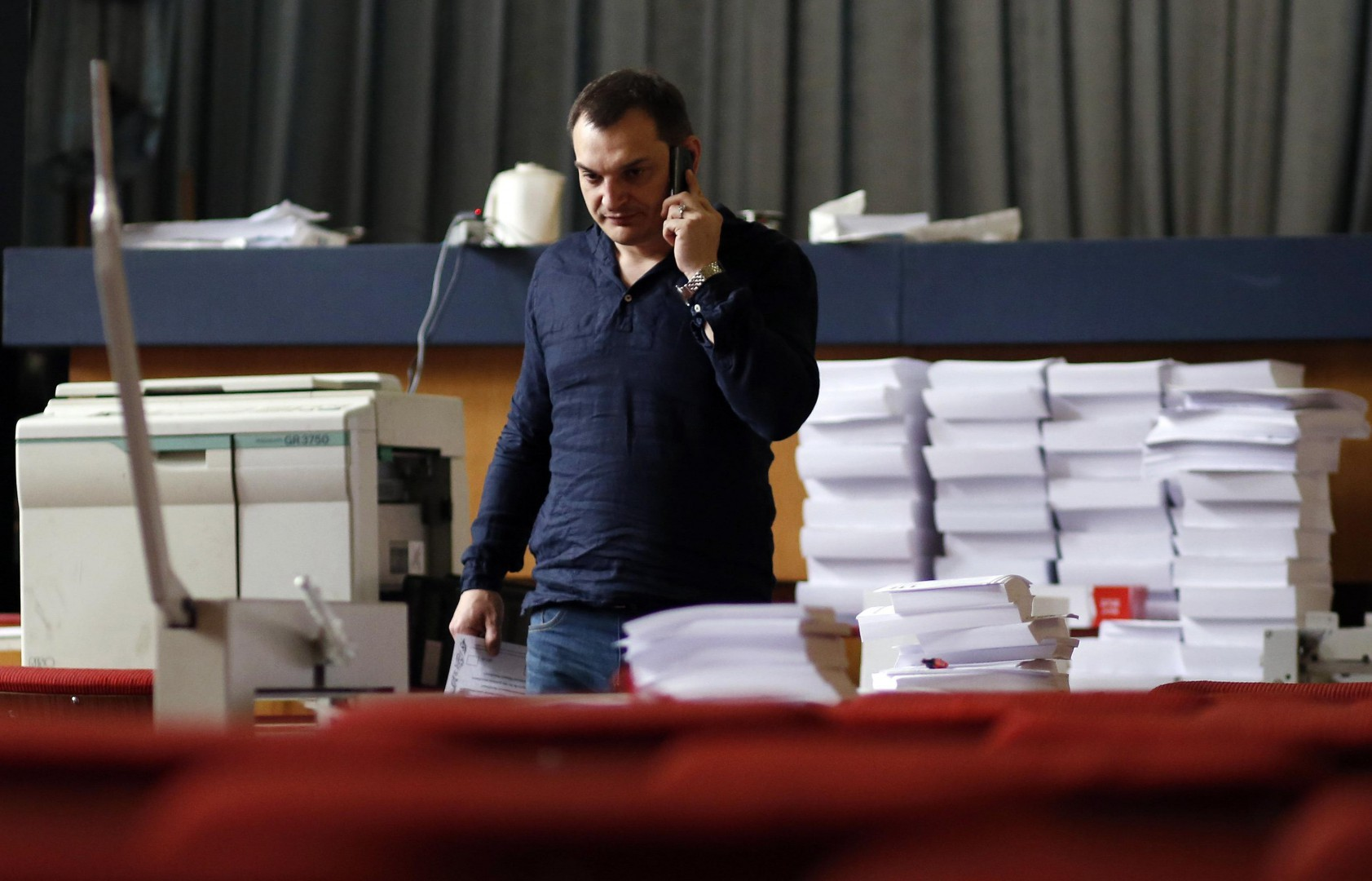 Roman Lyagin, leader of the separatist republic's election commission, talks on a mobile phone at the commission headquarters in Donetsk, eastern Ukraine May 8, 2014. Pro-Russian separatists in eastern Ukraine ignored a public call by Russian President Vladimir Putin to postpone a referendum on independence, declaring they would go ahead on May 11 with a vote that could lead to war.    REUTERS/Marko Djurica (UKRAINE - Tags: POLITICS CIVIL UNREST ELECTIONS)