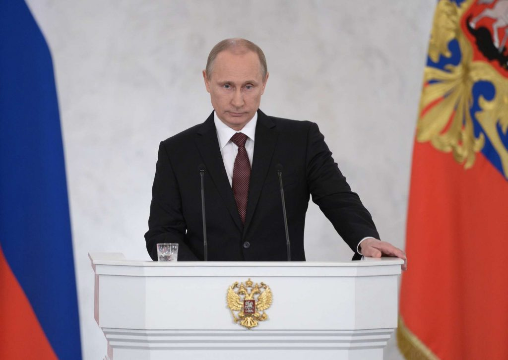 (140318) -- MOSCOW, MARCH 18, 2014 () -- RUSSIA'S PRESIDENT VLADIMIR PUTIN ADDRESSES A JOINT SESSION OF RUSSIAN PARLIAMENT ON CRIMEA IN THE KREMLIN IN MOSCOW, RUSSIA, MARCH 18, 2014. RUSSIAN PRESIDENT VLADIMIR PUTIN SIGNED AN AGREEMENT ON TUESDAY ACCEPTING THE REPUBLIC OF CRIMEA AND THE CITY OF SEVASTOPOL AS PART OF ITS TERRITORY, LIVE TV BROADCAST SHOWED. (/RIA NOVOSTI) (DJJ)