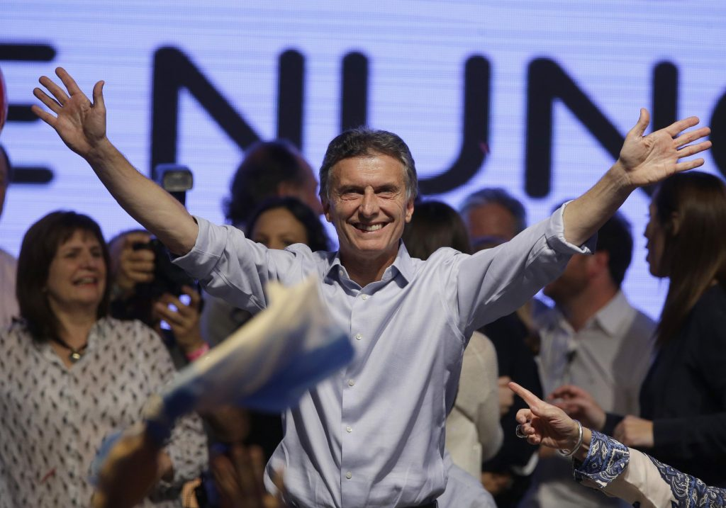 Supporters cheer top opposition presidential candidate Mauricio Macri in Buenos Aires, Argentina, Sunday, Oct. 25, 2015. Opposition leaders claimed Sunday night that Macri had gotten enough votes in Argentinas presidential election to force a runoff against ruling party presidential candidate, Buenos Aires Gov. Daniel Scioli. (ANSA/AP Photo/Jorge Saenz)