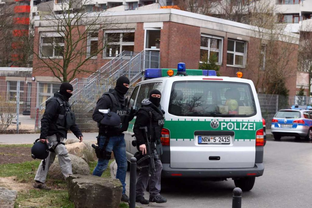 Members of Germany's elite police unit, the Spezialeinsatzkommando, or SEK, stand outside a child day care center where a man wielding a knife has taken a hostage in the Chorweiler suburb on April 5, 2013 in Cologne, Germany. According to police the man has taken the director of the center hostage and is demanding money. No children are in danger, nor are any children still in the center. (Photo by Christof Koepsel/Getty Images)