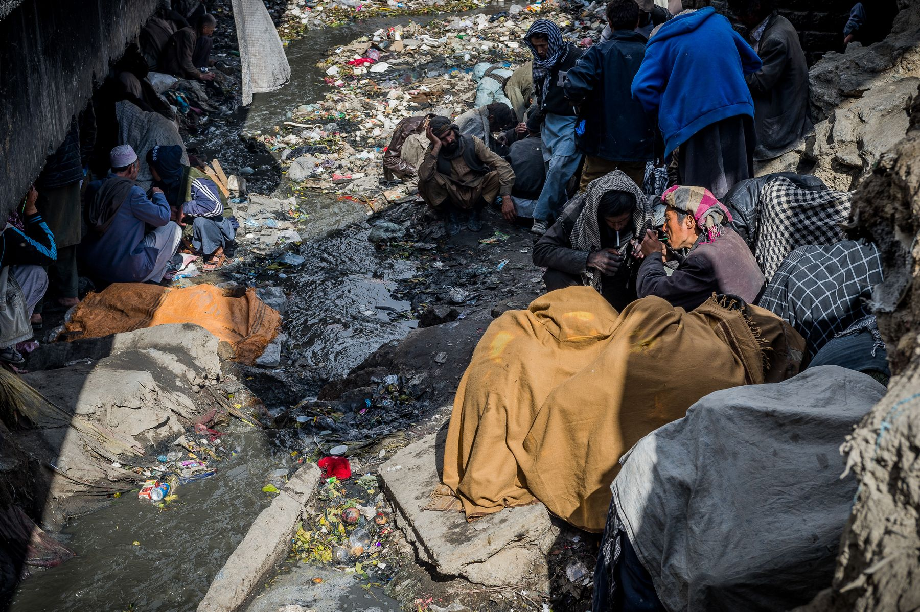 03 November 2015 - Kabul, Afghanistan. Daily life in the capital. Drug users find shelter under a bridge near the main bazaar of the city. The country is facing a pivotal period in its history as International armies such as US and Italy decided not to leave the country but to prolong the ongoing war against Talibans in support of the Afghan official Government.