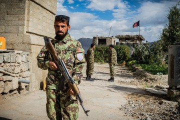 03 November 2015 - Kabul, Afghanistan. A soldier of the Afghan Government is seen while patroling the old House of the Parliament which was bombed several times during the war. Soldiers are regularly sent to lower-risk areas, such as Kabul, to let them have breaks from the frontlines. The country is facing a pivotal period in its history as International armies such as US and Italy decided not to leave the country but to prolong the ongoing war against Talibans in support of the Afghan official Government.