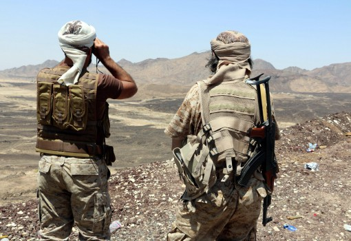epa04967945 Soldiers loyal to Yemen's Saudi-backed government hold a position during an offensive against Houthi positions in Marib province, Yemen, 07 October 2015. According to reports, the Saudi-backed Yemeni fighters have defeated the Houthi rebels in Marib province, flushing out the last strongholds of the Houthis and their army allies in Sirwah district, about 100km away from the rebel-controlled capital Sanaa.  EPA/STRINGER