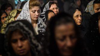 Fedeli cristiani in preghiera in Siria (LaPresse)