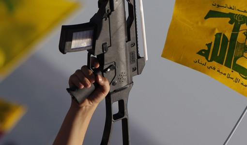 "A child holds up a plastic toy rifle and waves Hezbollah flag during a rally organized by supporters of Lebanon's Hezbollah to mark Quds (Jerusalem) Day in the southern Lebanese village of Maroun el-Ras, near the border with Israel August 26, 2011. Lebanon's Hezbollah chief Sayyed Hassan Nasrallah, whose group is backed by Damascus, warned that the unrest in Syria will have implications on the whole region if it is not solved through dialogue. ""We all support the need for big and important reforms, so Syria can be stronger... this means that all efforts should be combined to calm the situation in Syria and push it towards dialogue and peaceful solution,"" he said. REUTERS/Ali Hashisho    (LEBANON - Tags: POLITICS RELIGION)"