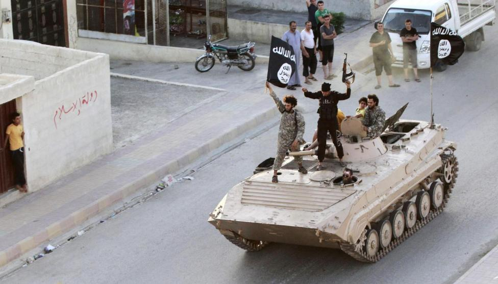 Militant Islamist fighters take part in a military parade along the streets of northern Raqqa province in Syria, June 30, 2014.  REUTERS/Stringer
