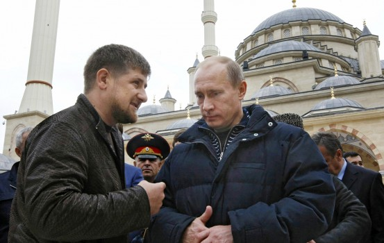Russian Prime Minister Vladimir Putin, right, listens to Chechen regional President Ramzan Kadyrov in Grozny, Chechnya, Thursday, Oct. 16, 2008. Putin arrived in Chechnya for a working tour. (AP Photo/RIA-Novosti, Alexei Nikolsky, Pool)