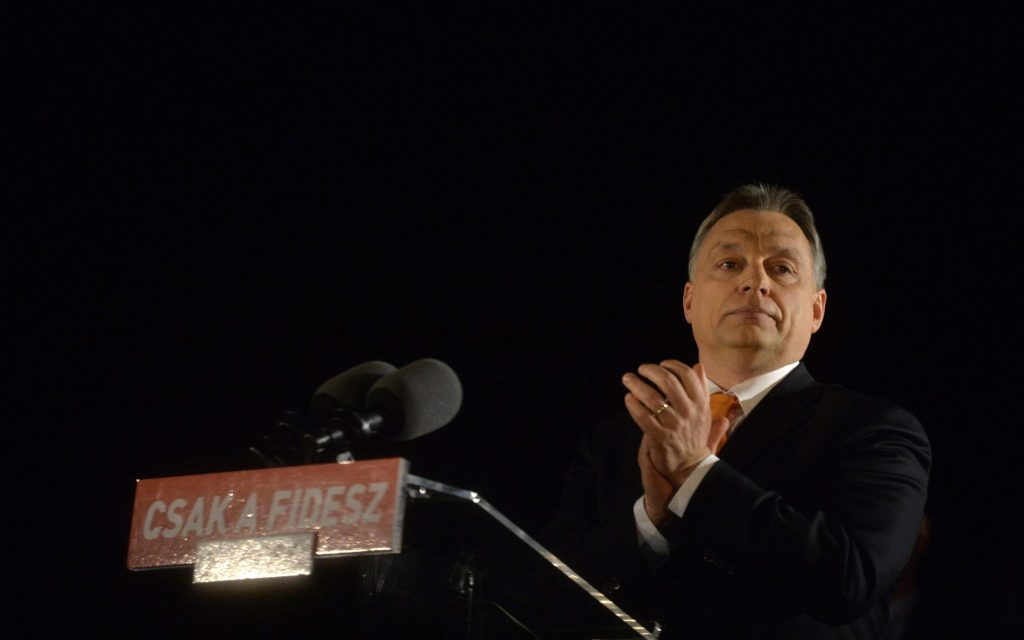 epa04157394 Hungarian Prime Minister Viktor Orban, leader of the ruling centre-right Fidesz party is seen prior to his victory speech after the parliamentary elections, in downtown Budapest, Hungary, 06 April 2014. Hungarian Prime Minister Viktor Orban's conservative Fidesz party on 06 April repeated a landslide triumph from four years ago and may be able to govern virtually unchallenged.  EPA/Szilard Koszticsak HUNGARY OUT