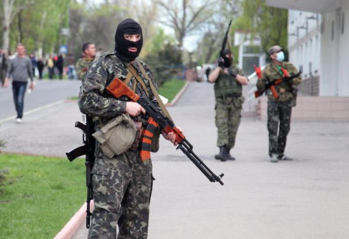 epa04185386 Pro-Russian armed men block the regional police office in Lugansk, Ukraine, 29 April 2014. Protesters in eastern Ukraine seized another key administrative building on Tuesday as the European Union and Russia traded barbs about the latest round of Western sanctions. A more-than-2,000-strong pro-Russian crowd stormed the regional administration building in Luhansk, local media reported. The activists, many of them wearing masks and camouflage, were met with no resistance from police and hoisted the Russian flag, the ostro.org news site reported.  EPA/ZURAB KURTSIKIDZE