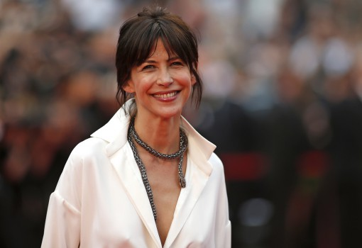 "Jury member actress Sophie Marceau poses on the red carpet as she arrives for the screening of the film ""Mad Max: Fury Road"" out of competition at the 68th Cannes Film Festival in Cannes, southern France, May 14, 2015.              REUTERS/Benoit Tessier - RTX1CZZO"