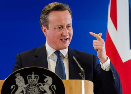 British Prime Minister David Cameron speaks during a final press conference at an EU summit in Brussels on Friday, Feb. 19, 2016. British Prime Minister David Cameron pushed a summit into overtime Friday after a second day of tense talks with weary European Union leaders unwilling to fully meet his demands for a less intrusive EU. (ANSA/AP Photo/Geert Vanden Wijngaert)