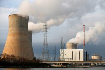 Steam billows from the cooling towers of the Tihange nuclear plant of Electrabel, the Belgian unit of French company Engie, former GDF Suez, in Tihange, Belgium, December 29, 2015. REUTERS/Francois Lenoir