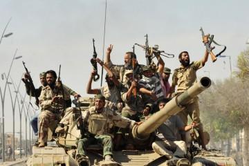 reuters_libya_sirte_fighters_20Oct11-878x578