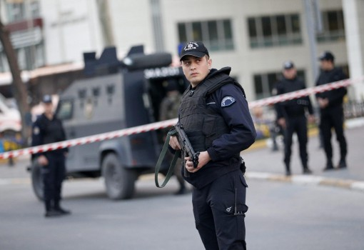 epa04689118 Turkish policemen secure the area in front of the Istanbul Police Headquarter after an attack by an armed woman and man, in Istanbul, Turkey, 01 April 2015. The female attacker was killed while the man was captured by police, according to Turkish media.  EPA/SEDAT SUNA