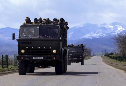 Volunteers drive trucks in the direction towards the frontline to join the self-defense army of Nagorno-Karabakh on a road in the breakaway Nagorno-Karabakh region, April 4, 2016. REUTERS/Hrayr Badalyan/PAN Photo