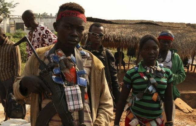 An Anti-balaka child soldier wears lucky charms around his neck while he poses for a picture in Ouengo district, 7th arrondissement in Bangui, in a file photo. REUTERS/Emmanuel Braun