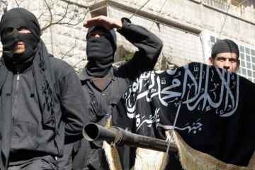 (FILES) A picture taken on October 25, 2013 shows members of jihadist group Al-Nusra Front taking part in a parade calling for the establishment of an Islamic state in Syria, at the Bustan al-Qasr neighbourhood of Aleppo. Al-Qaeda chief Ayman al-Zawahiri has ordered on November 8, 2013 the disbanding of the main jihadist faction in Syria, the Islamic State of Iraq and the Levant and also stressed that the Al-Nusra Front was the branch of the global jihadist group in Syria.  AFP PHOTO / KARAM AL-MASRI