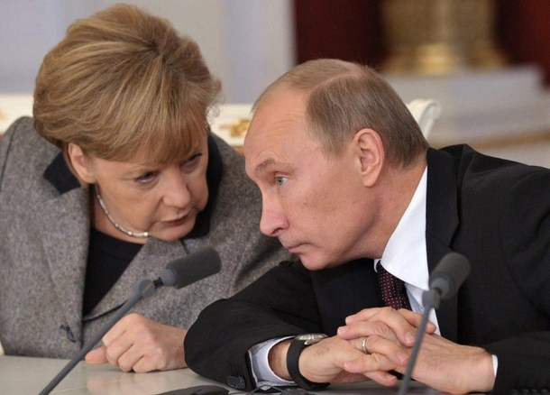Russia's President Vladimir Putin (R) speaks with German Chancellor Angela Merkel as they meet in the Kremlin in  Moscow, on November 16, 2012. A fluent German speaker who spent five years as a KGB agent in Dresden, Putin has long prided himself on building a solid working relationship with Merkel yet it has lacked the warmth seen under her predecessor Gerhard Schroeder. AFP PHOTO / RIA-NOVOSTI / POOL/ ALEXEI NIKOLSKY