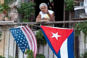 1458229073-cuba-united-states-flags400