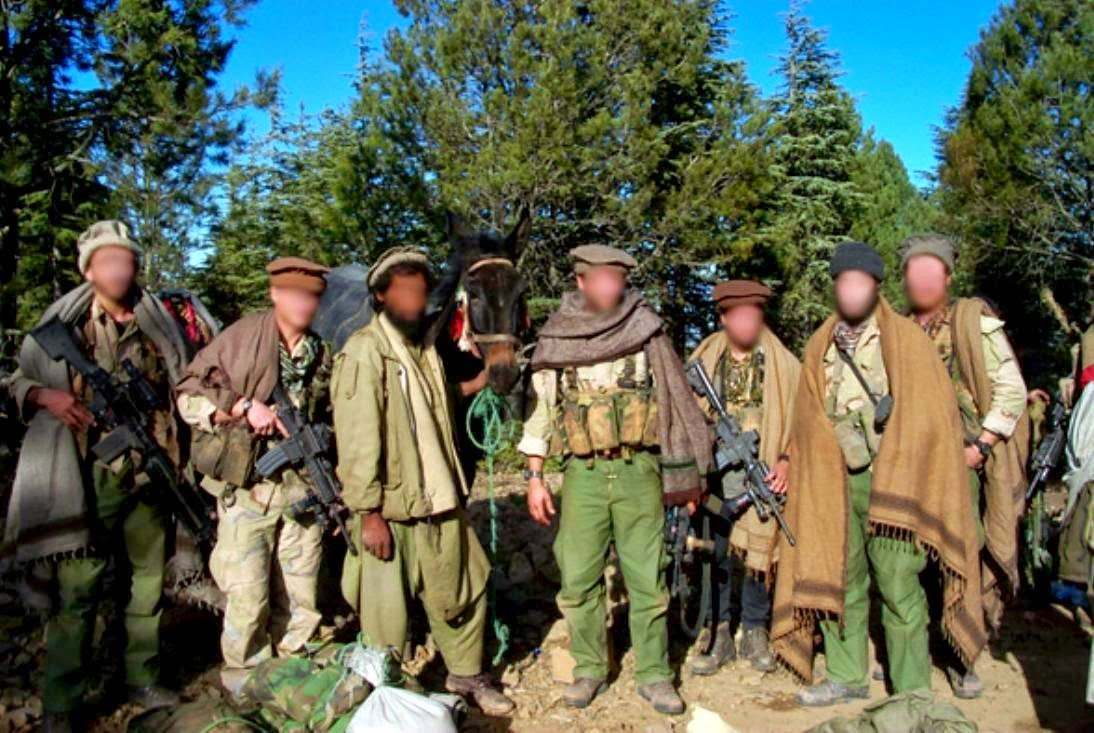 Delta_force_GIs_disguised_as_Afghan_civilians,_November_2001_C