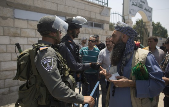 JERUSALEM, ISRAEL - JULY 21:  (ISRAEL OUT)  Israeli border police officers speaks  to a Palestinian worshipper before a friday pray in Ras el-Amud Area outside the Old City on July 21, 2017 in Jerusalem, Israel. Following last Friday terror attack at the holy site of Al Aqsa mosque Israeli police barred men under 50 from entering the Old City for Friday Muslim prayers as tensions rose and protests erupted over new security measures at the highly sensitive Al-Aqsa mosque compound.  (Photo by Lior Mizrahi/Getty Images)