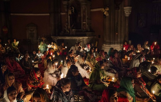 """Asia, Pakistan, Lahore. 17/04/2017. The Easter vigil in the Lahore Cathedral. Christians represent the 2.5% of the population. The Islamic Sharia brought persecution and strong discrimination towards this minority forced to humble work. The main problem is the law that condemned blasphemy. Each type of controversy between Christians and Muslims is often resolved from Muslims accusing the """"other side"""" of this kind of crime for which you can be put in jail with capital law with only one available testimony."""