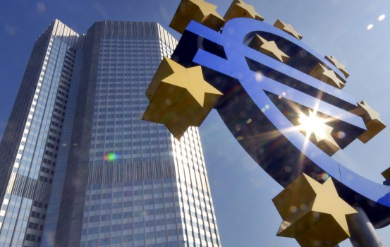 ** FILE ** A Euro sculpture is seen in the autumnal sun in front of the European Central Bank ECB building, rear, in Frankfurt, Germany, in this Sept. 24, 2007 file picture. The European Central Bank, along with the U.S. Federal Reserve and others, plans to offer billions in short-term credit to banks in Europe to meet their demand for dollars amid tense financial markets. (AP Photo/Bernd Kammerer)