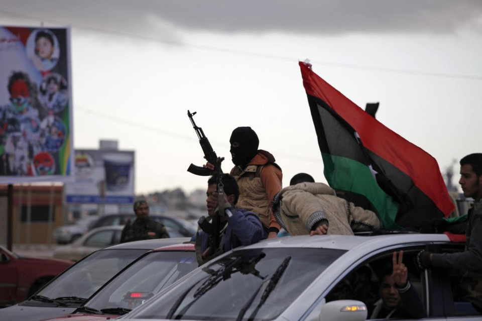 Libyan gunman celebrate on the early morning of the second anniversary of the revolution that ousted Moammar Gadhafi, in Benghazi, Libya, Sunday, Feb. 17, 2013.  (AP Photo/Mohammad Hannon)