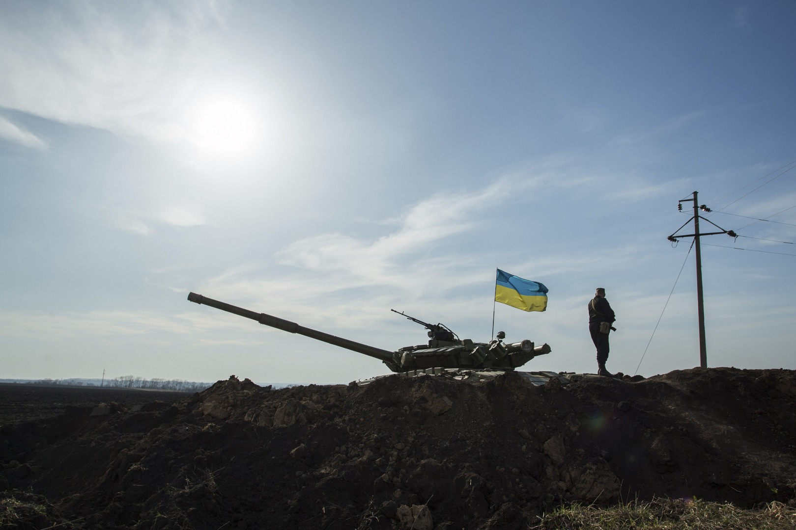 A soldier stands guard near a tank position close to the Russian border near the Ukrainian city of Kharkiv in this March 24, 2014 file photo. Six years after losing land in a war with Russia, Georgians believe the struggle for Ukraine will decide their own fate, and hope NATO and the European Union will now speed up their integration into the Western fold. Picture taken March 24, 2014. To match Analysis story UKRAINE-CRISIS/GEORGIA   REUTERS/Dmitry Neymyrok/Files (UKRAINE - Tags: POLITICS MILITARY)