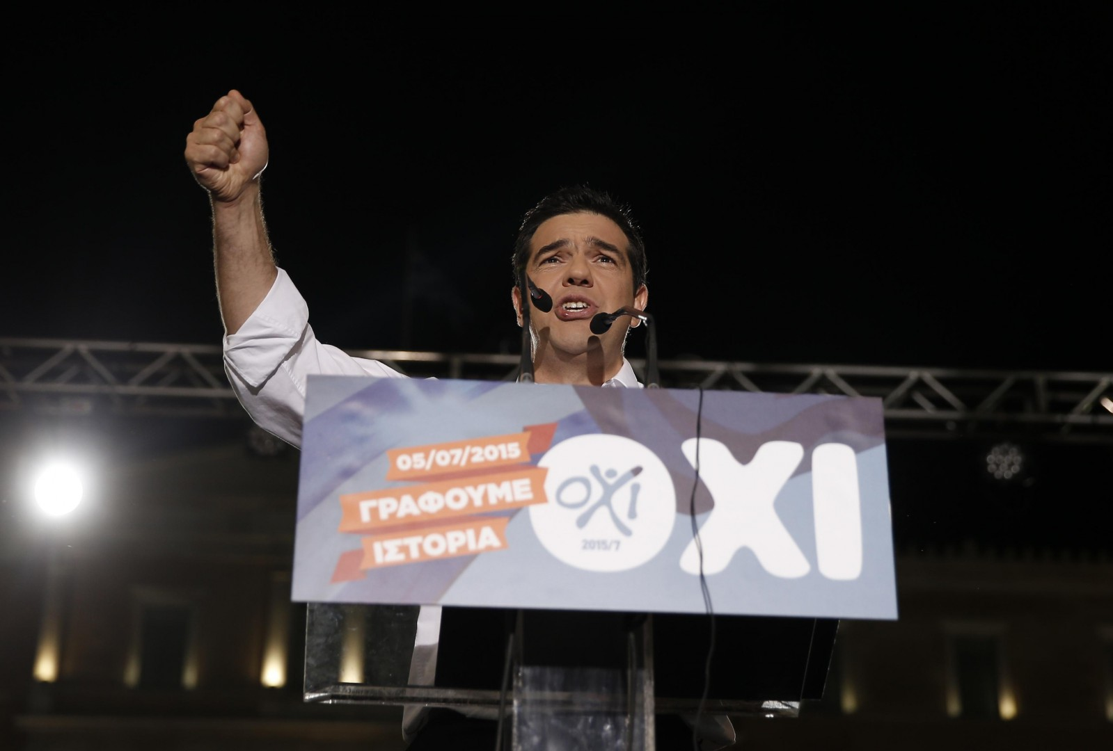 Greece's Prime Minister Alexis Tsipras delivers a speech during a rally organized by supporters of the No vote in Athens, Friday, July 3, 2015. A new opinion poll shows a dead heat in Greece's referendum campaign with just two days to go before Sunday's vote on whether Greeks should accept more austerity in return for bailout loans. The podium reading ''We are writing history, NO.''  (ANSA/AP Photo/Petros Giannakouris)