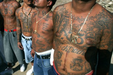 FILE - In this Nov.24, 2005 file photo shows unidentified members of the gang Mara Salvatrucha who are incarcerated in the National Penitentiary of Tamara, in Tegucigalpa, Honduras. The deadliest prison blaze in a century has drawn attention to an unfortunate U.S. export to Central America, street gangs. Prisons in Honduras and elsewhere in Central America are teeming with inmates who belong to gangs that have their roots in Southern California. Refugees of the region's civil wars sowed a new breed of violence on the streets of Los Angeles in the 1980s. (AP Photo/Esteban Felix,File)