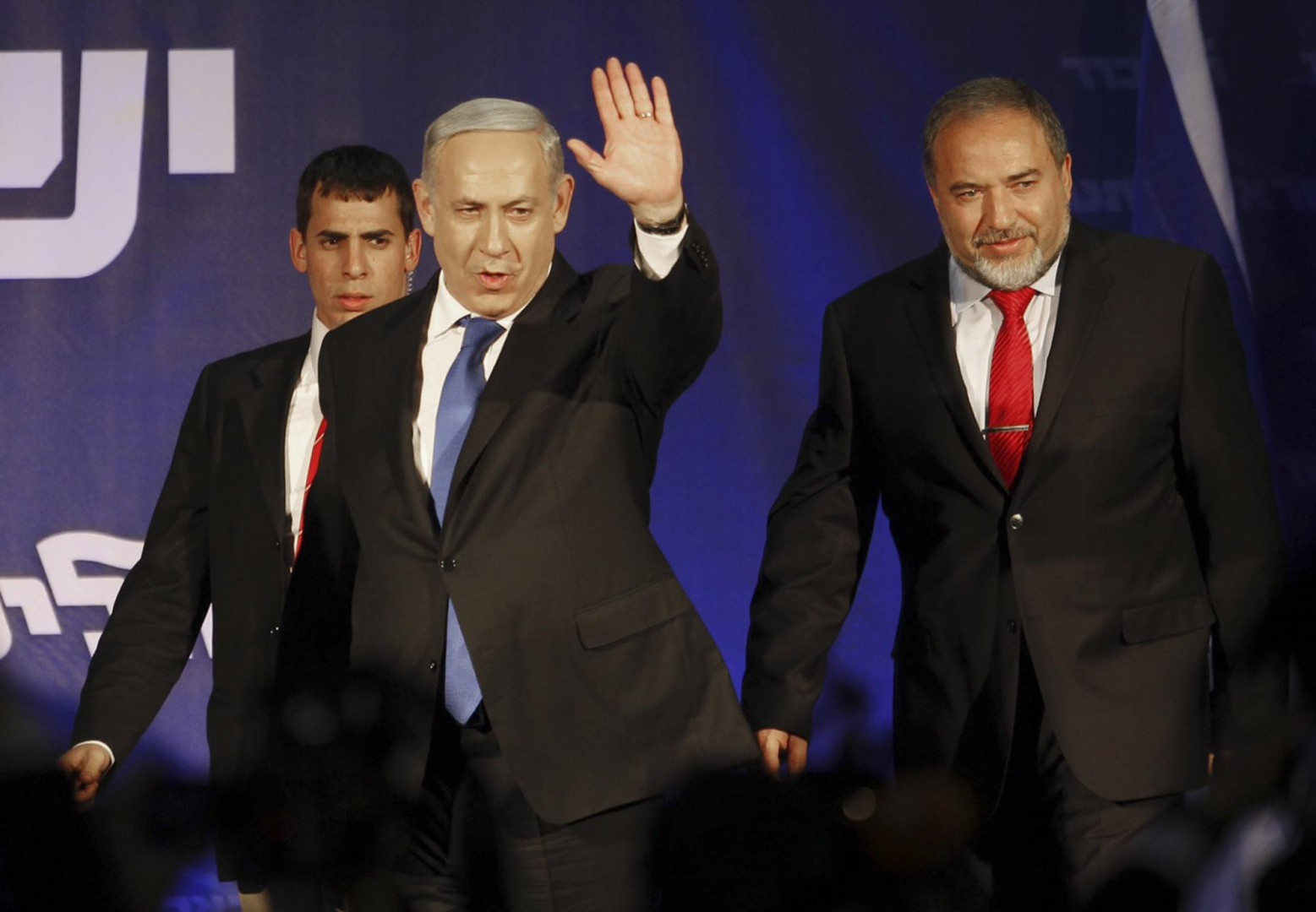 FILE - In this Wednesday, Jan. 23, 2013, file photo, Israel's Prime Minister Benjamin Netanyahu and former Foreign Minister Avigdor Lieberman greet their supporters in Tel Aviv, Israel. Israels incoming defense minister once called for bombing Egypt, just weeks ago suggested that Israel kill Hamas leader in the Gaza Strip and has opposed prosecution of a soldier accused of manslaughter _ just a few of the positions that could put former bar bouncer Avigdor Lieberman at odds with a military he now commands. (ANSA/AP Photo/Ariel Schalit, File) [CopyrightNotice: AP2012]