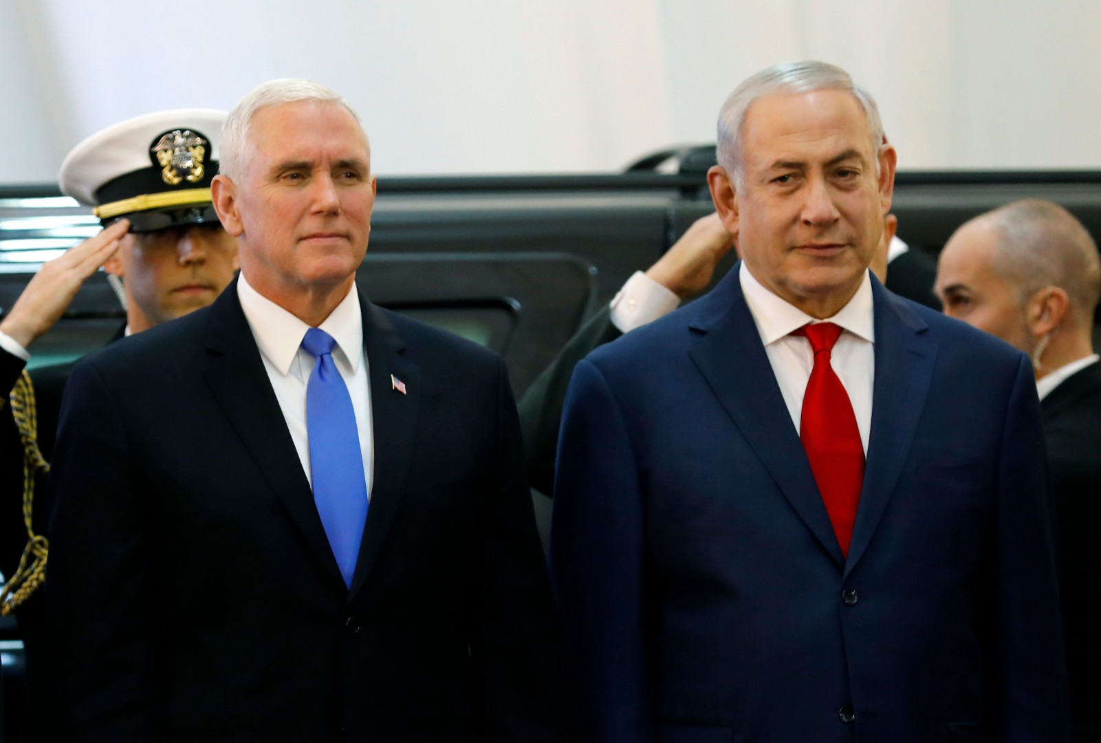 US Vice President Mike Pence (L) is welcomed by Israeli Prime Minister Benjamin Netanyahu at a ceremony at the Prime Minister's Office in Jerusalem on January 22, 2018. The visit, initially scheduled for December before being postponed, is the final leg of a trip that has included talks in Egypt and Jordan as well as a stop at a US military facility near the Syrian border. Controversy back home over a budget dispute that has led to a US government shutdown has trailed Pence, and he sought to blame Democrats for the impasse during a speech to troops at the military facility a day earlier. / AFP PHOTO / Menahem KAHANA