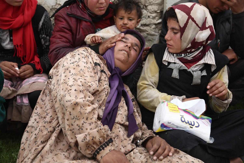 Una donna siriana in fuga da Tal Aswad, Afrin // AFP Photo/Nazeer al-Khatib