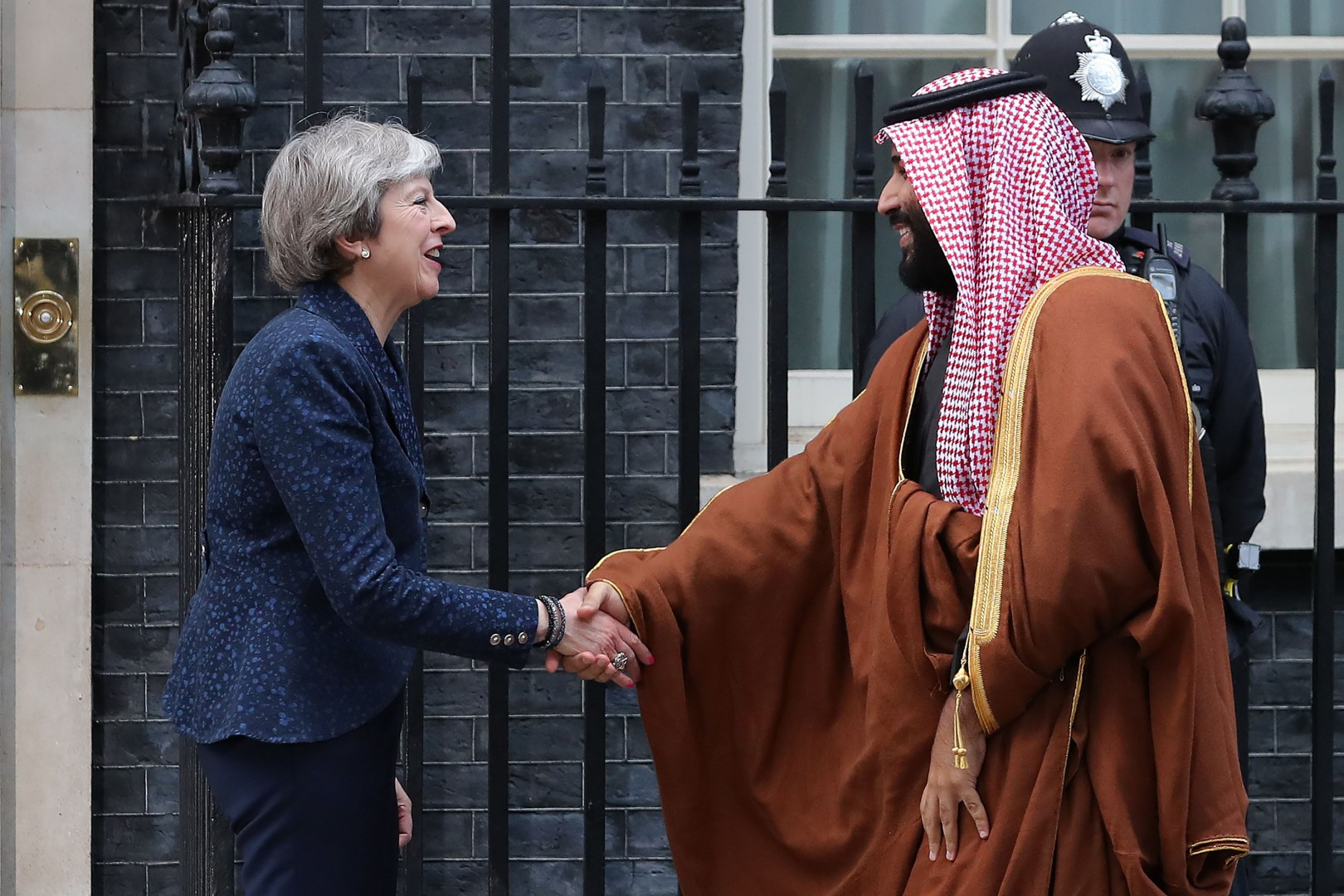 "Britain's Prime Minister Theresa May (L) greets Saudi Arabia's Crown Prince Mohammed bin Salman (R) outside 10 Downing Street, in central London on March 7, 2018. British Prime Minister Theresa May will ""raise deep concerns at the humanitarian situation"" in war-torn Yemen with Saudi Crown Prince Mohammed bin Salman during his visit to Britain beginning Wednesday, according to her spokesman. / AFP PHOTO / Daniel LEAL-OLIVAS"