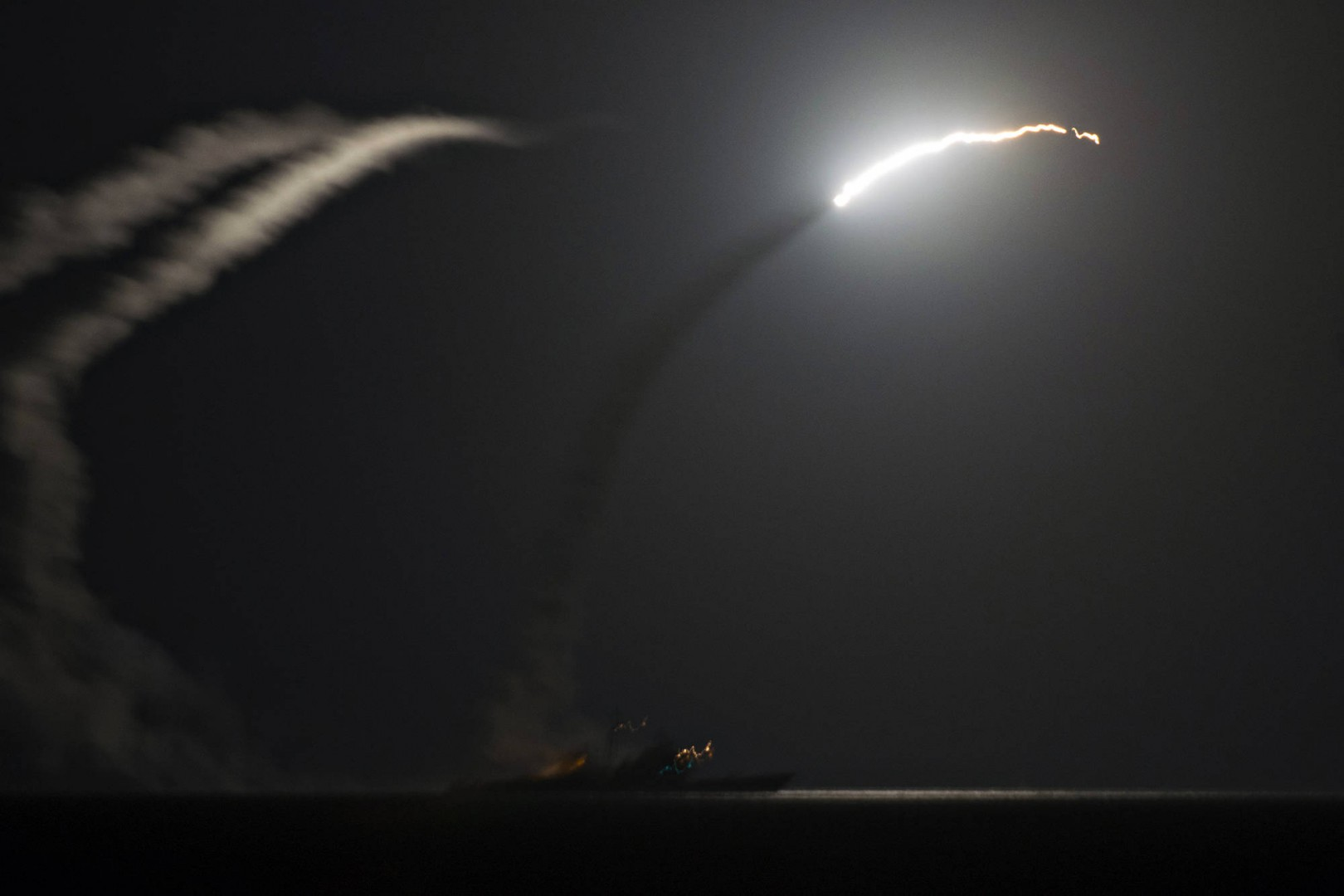APRIL 6, 2017, FILE PHOTO, PRESIDENT TRUMP ORDERED A MASSIVE MILITARY STRIKE ON A SYRIAN AIR BASE IN RETALIATION FOR A BARBARIC CHEMICAL ATTACK HE BLAMED ON SYRIA S PRESIDENT. NAVY GUN SHIPS USS PORTER AND USS ROSS TARGETED SHAYRAT AIRFIELD IN SYRIA, WHERE PLANES THAT CARRIED OUT THE CHEMICAL ATTACK WHERE LAUNCHED FROM. PICTURED: SEPT. 23, 2014, USS GEORGE H.W. BUSH, UNITED STATES OF AMERICA, THE GUIDED MISSILE CRUISER USS PHILIPPINE SEA LAUNCHES A TOMAHAWK CRUISE MISSILE DURING AN ATTACK ON ISIS TARGETS IN SYRIA SEPTEMBER 23, 2014 IN THE PERSIAN GULF SEPT. 23, 2014. THE SHIP IS PART OF THE USS GEORGE H.W. BUSH CARRIER STRIKE GROUP AND TOOK PART IN THE FIRST WAVE OF ATTACKS ON TARGETS IN SYRIA. (CREDIT IMAGE: (C) MCS1 ERIC GARST/U.S. NAVY/ZUMA WIRE/ZUMAPRESS.COM) ZSELECT, ZAGENCY, USN, TOMAHAWK, CRUISE, MISSILE, LAUNCH, USS, PHILIPPINE, SEA, MILITARY, ARMED, FORCES, ISIS, ISIL, ISLAMIC, STATE, SYRIA, IRAQ, WAR, COMBAT, MISSION, ATTACK, MIDDLE, EAST, MIDEAST, WARFARE, US, USA, AMERICAN, UNITED, STATES, NIGHT, OUTSIDE, NIGHTTIME, COPY, SPACE, COPYSPACE, HORIZONTAL, NAVY, ZWIRE, TOMAHAWK_MISSILE_20138, JPG, 20140923_ZAA_P138_026, 20170406_SHA_Z03_923.JPG, 20170406_SHA_Z03_923.JPG