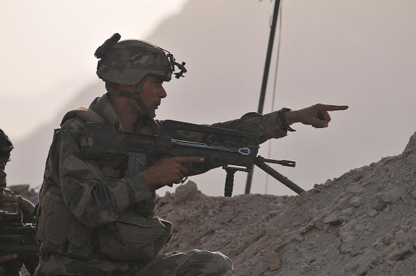 KAPISA PROVINCE, Afghanistan – A French marine with Task Force Korrigan points out the location of insurgents after taking small arms and rocket propelled grenade fire at Combat Outpost Belda in the Shpee valley of Kapisa province, Afghanistan, Aug. 7. Three Afghan National Army companies, supported by 500 French marines serving with International Security Assistance Forces, and Coalition force elements, conducted a large operation intended to deny the enemy safe haven and contribute to election security in Shpee, Aug. 6-8. (Photo by U.S. Army 1st Lt. Lory Stevens, Task Force Warrior Public Affairs)