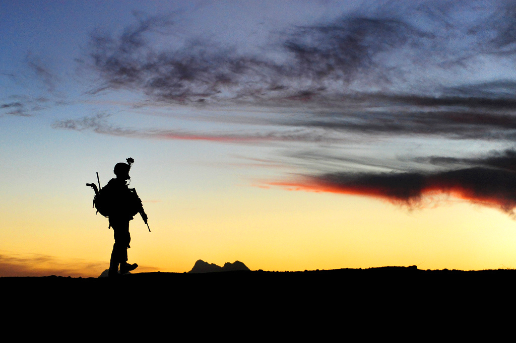 A U.S. Soldier with Charlie Company, 1st Battalion, 17th Infantry Regiment walks to a joint district community center after securing combat outpost Rajankala in the Kandahar province of Afghanistan Nov. 26, 2009. (DoD photo by Tech. Sgt. Francisco V. Govea II, U.S. Air Force/Released)