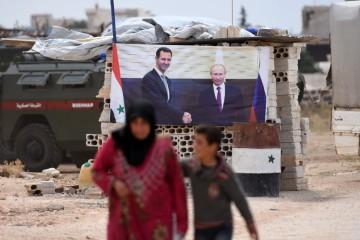 L'immagine di Putin e Assad in Siria (LaPresse)