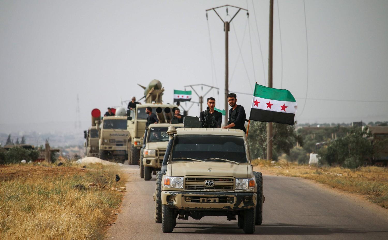 Uomini dell'Esercito siriano libero a Daraa, nel sud della Siria (LaPresse)