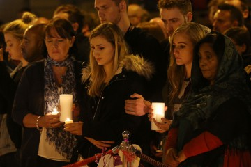 Mourners light candles and pause for a minute's silence in St Ann's Square, Manchester, as they mark the passing of exactly a week since the Manchester Arena terror attack. PRESS ASSOCIATION Photo. Picture date: Monday May 29, 2017. See PA story POLICE Explosion. Photo credit should read: Jonathan Brady/PA Wire