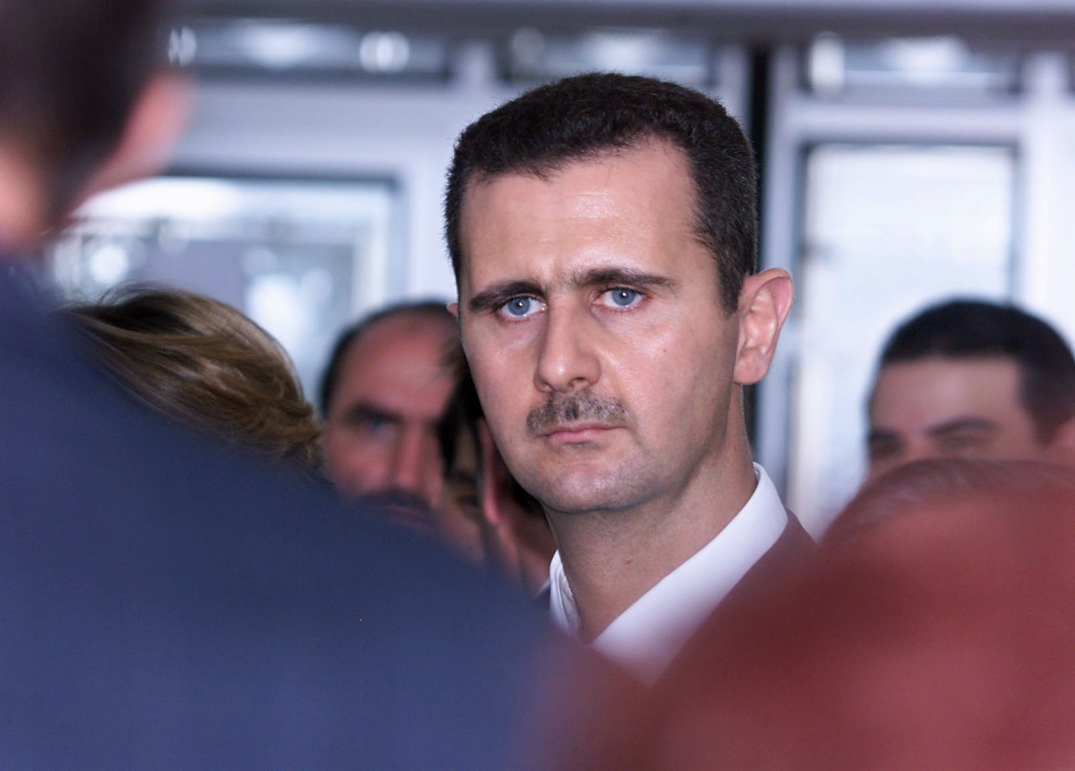 "(FILES) In this file photo taken on June 26, 2001 Syrian President Bashar al-Assad is seen during his visit at the Arab World Institute in Paris. France has initiated a procedure for the withdrawal of the Legion of Honor attributed to Syrian President Bashar al-Assad, said on April 16, 2018 evening to AFP the entourage of President Emmanuel Macron. ""The Elysee confirms that a disciplinary procedure of withdrawal of the Legion of Honor"", the highest French distinction, ""against Bashar al-Assad has been committed,"" said the Presidency of the Republic. / AFP PHOTO / Jack GUEZ"