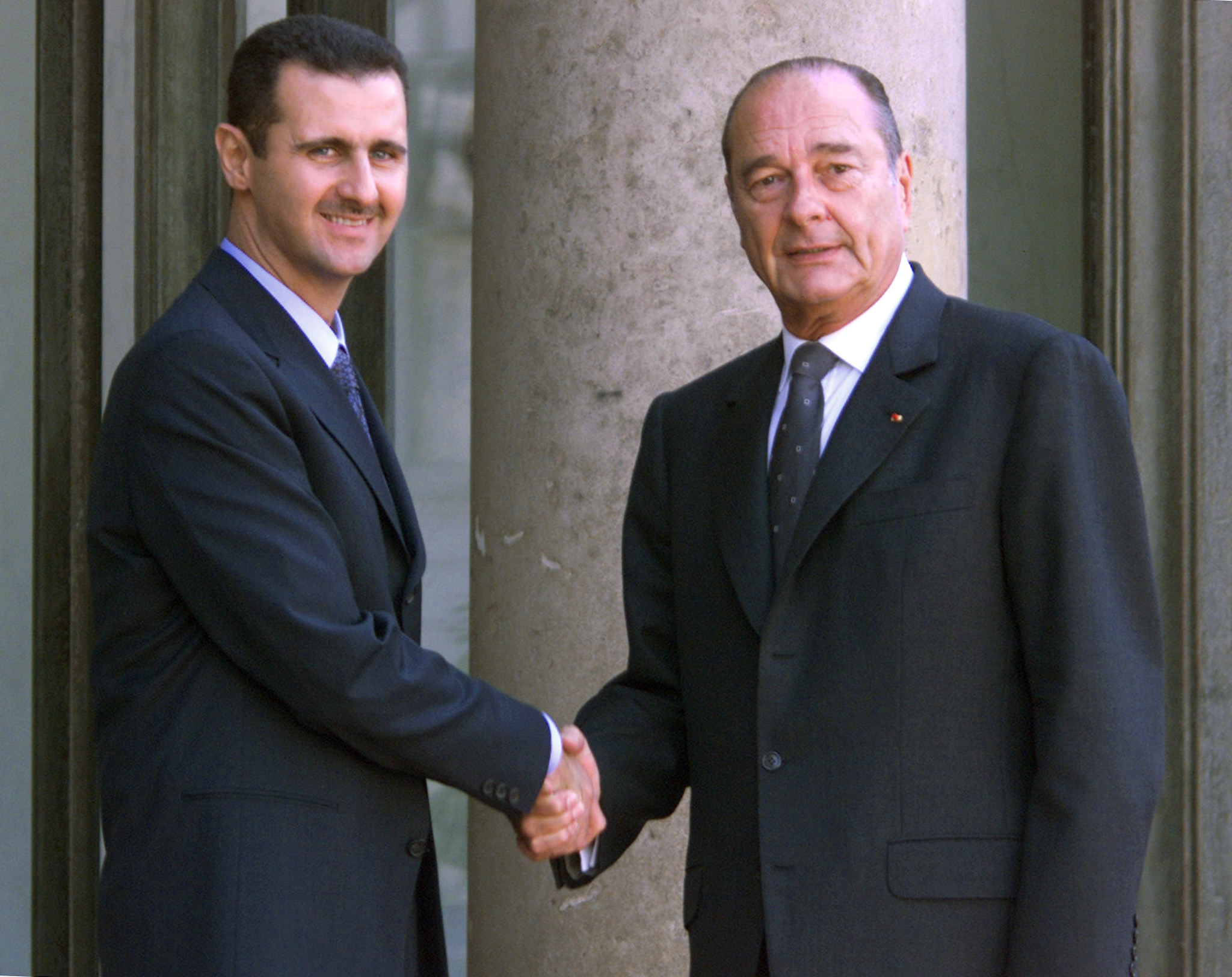 "(FILES) In this file photo taken on June 25, 2001 Syrian President Bashar al-Assad (L) is greeted by French President Jacques Chirac before their meeting at the Elysee Palace in Paris. France has initiated a procedure for the withdrawal of the Legion of Honor awarded to Syrian President Bashar al-Assad by then French President Jacques Chirac said on April 16, 2018 evening to AFP the entourage of President Emmanuel Macron. ""The Elysee confirms that a disciplinary procedure of withdrawal of the Legion of Honor"", the highest French distinction, ""against Bashar al-Assad has been committed,"" said the Presidency of the Republic. / AFP PHOTO / Jack GUEZ"