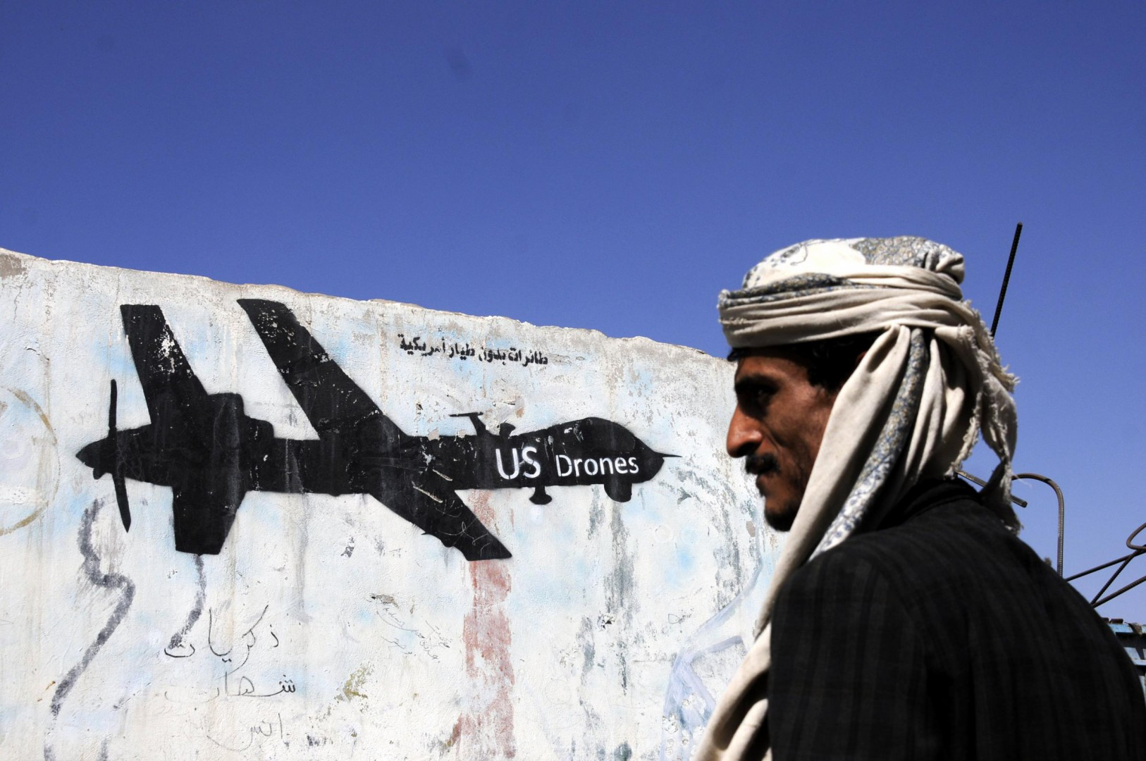 (170130) -- SANNA , Jan. 30, 2017 (Xinhua) -- A Yemeni man walks near a painting of US drone on the wall in Sanaa, Yemen, on Jan. 29, 2017. At least 25 civilians were killed in the latest U.S. counter-terror raid in Yemen on Sunday, tribal and local sources in Baida province told Xinuha.  (Xinhua/Mohammed Mohammed)