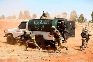 Una simulazione della battaglia di Idlib organizzata dai jihadisti di Al Nusra (LaPresse)