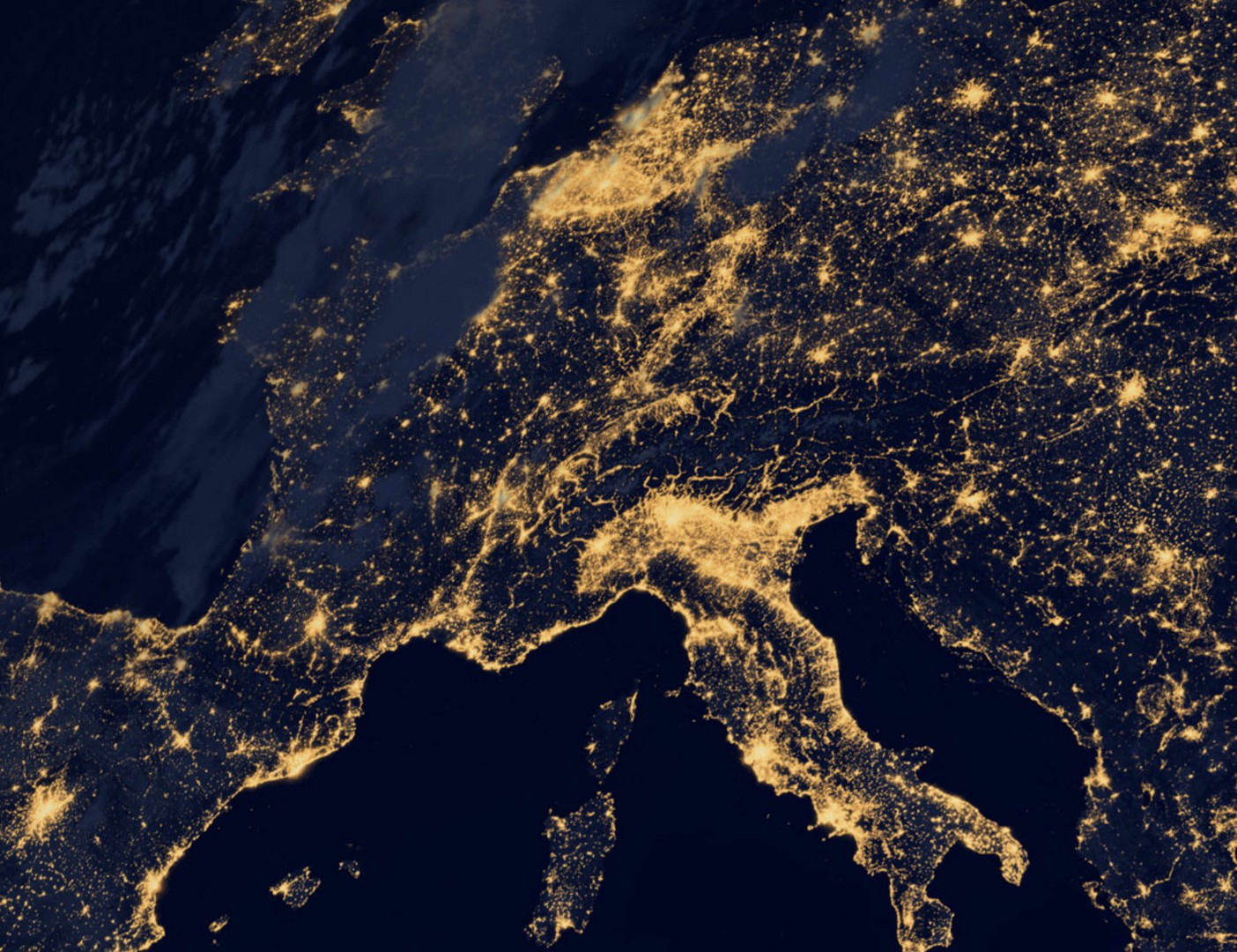 "This new image of Europe, Africa, and the Middle East at night is a composite assembled from data acquired by the Suomi NPP satellite in April and October 2012. The new data was mapped over existing Blue Marble imagery of Earth to provide a realistic view of the planet. The nighttime view was made possible by the new satellite's ""day-night band"" of the Visible Infrared Imaging Radiometer Suite. VIIRS detects light in a range of wavelengths from green to near-infrared and uses filtering techniques to observe dim signals such as gas flares, auroras, wildfires, city lights, and reflected moonlight. In this case, auroras, fires, and other stray light have been removed to emphasize the city lights. ""Night time imagery provides an intuitively graspable view of our planet,"" says William Stefanov, senior remote sensing scientist for the International Space Station program office. ""They provide a fairly straightforward means to map urban versus rural areas, and to show where the major population centers are and where they are not."" Named for satellite meteorology pioneer Verner Suomi, NPP flies over any given point on Earth's surface twice each day at roughly 1:30 a.m. and p.m. The polar-orbiting satellite flies 824 kilometers (512 miles) above the surface, sending its data once per orbit to a ground station in Svalbard, Norway, and continuously to local direct broadcast users distributed around the world. The mission is managed by NASA with operational support from NOAA and its Joint Polar Satellite System, which manages the satellite's ground system. Learn more about the VIIRS day-night band and nighttime imaging of Earth in our new feature story: Out of the Blue and Into the Black. NASA Earth Observatory image by Robert Simmon, using Suomi NPP VIIRS data provided courtesy of Chris Elvidge (NOAA National Geophysical Data Center). Suomi NPP is the result of a partnership between NASA, NOAA, and the Department of Defense. Caption by Mike Carlowicz. Instrument:  Suomi NPP - VIIRS"