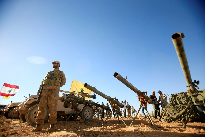Gli Hezbollah durante un'operazione militare (LaPresse)