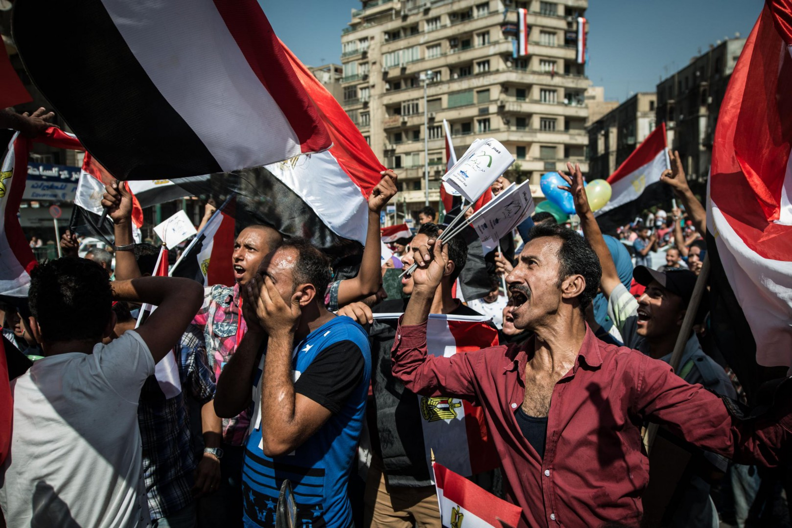 "(150806) -- CAIRO, Aug. 6, 2015 (Xinhua) -- Egyptian men chant slogans as celebrating the inauguration of the ""New Suez Canal"" at Tahrir Square in Cairo, Egypt, on Aug. 6, 2015. (Xinhua/Pan Chaoyue)(azp)"