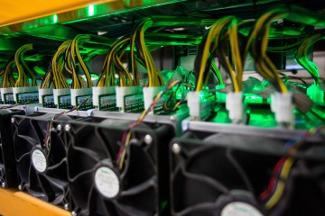 Bitcoin mining is viewed at BitFarms in Saint Hyacinthe, Quebec, on March 19, 2018. Bitcoin is a cryptocurrency and worldwide payment system. It is the first decentralized digital currency, as the system works based on the blockchain technology without a central bank or single administrator. / AFP PHOTO / Lars Hagberg