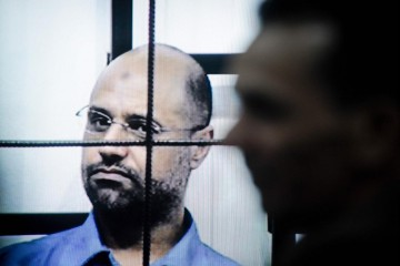 (150728) -- TRIPOLI, July 28, 2015 (Xinhua) -- This file photo taken on April 27, 2014 shows Saif al-Islam Gaddafi on trial via video-conference software in a courtroom in Zintan, Libya. A Libyan court on Tuesday sentenced Saif al-Islam Gaddafi, son of the former leader Muammar Gaddafi, to death, according to local judicial resources. (Xinhua/Zhang Yuan)